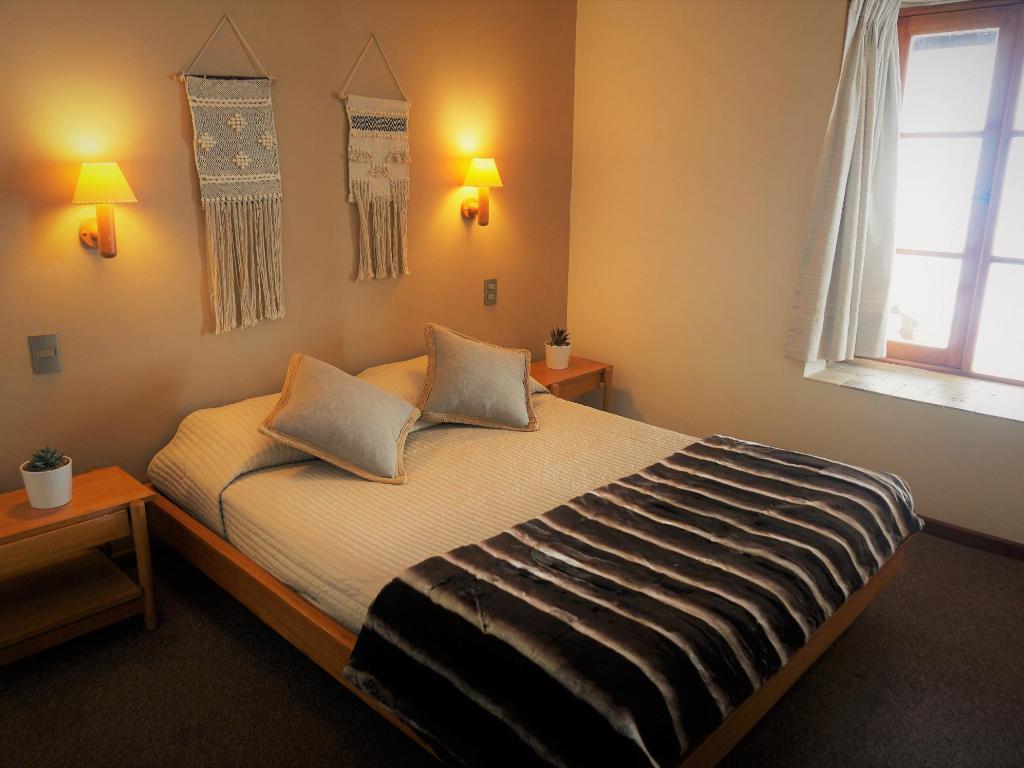 Habitación con cama matrimonial - Departamento Tipo A 102