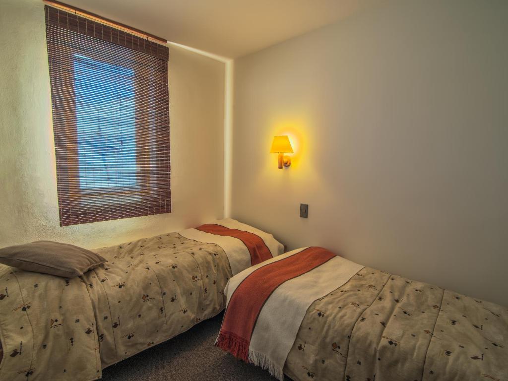 Habitación con dos camas Departamento Tipo B - 223