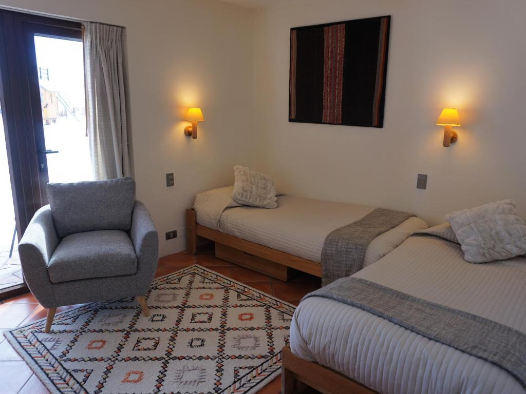 Sala con dos camas - Departamento Tipo A 103