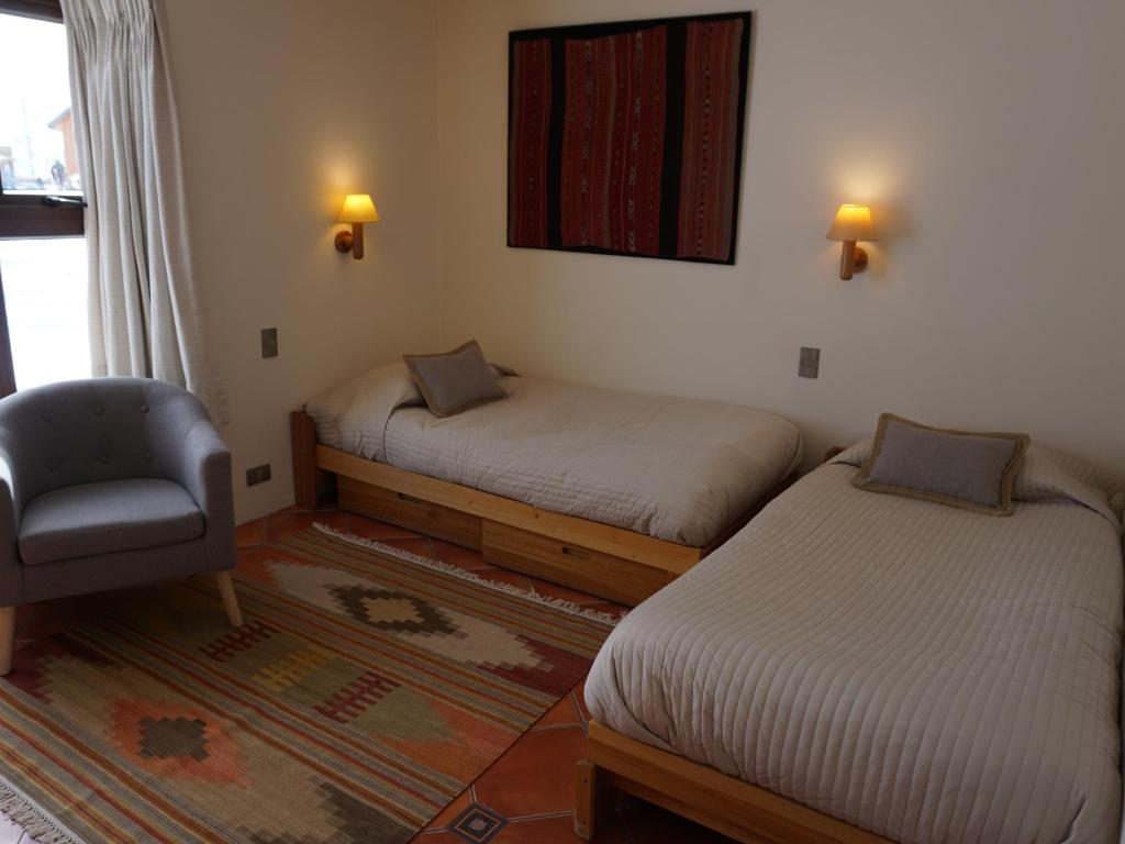 Sala con dos cama - Departamento Tipo A 102